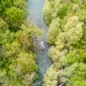 Rafting aerial view on a river trough the woods